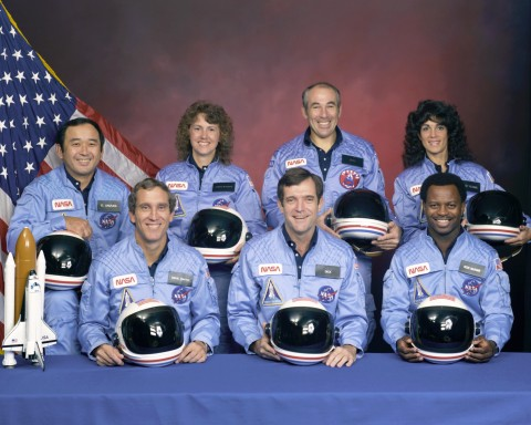 Front row: Michael J. Smith, Dick Scobee, Ronald McNair; Back Row: Ellison Onizuka, Christa McAuliffe, Gregory Jarvis, Judith Resnik